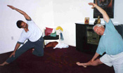 360 Yoga Albuquerque by Rev. Dr. Nancy from her personal collection (Jon & Bernie in Parighasana: Gate Lock Pose)