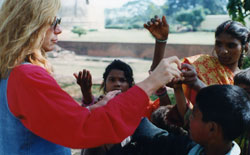 Rev. Dr. Nancy feeding hungry children of India, from her healing quotes collection, '90s